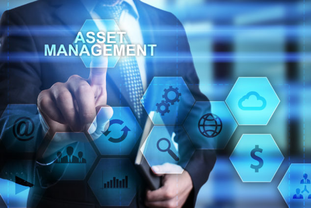 Businessman pressing button on touch screen interface and select asset management. busines concept.